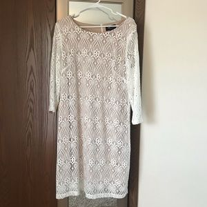RN studio white lace dress with nude background